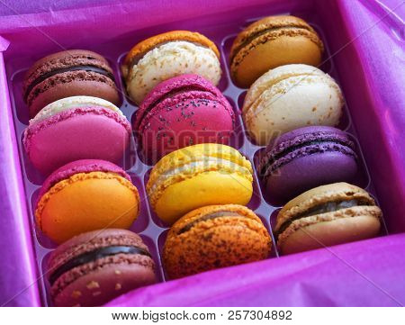 A Colorful Box Of French Macarons In A Box.