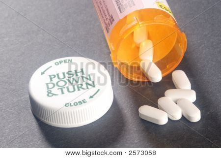Cholesterol Pills And Prescription Bottle