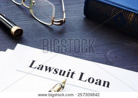 Lawsuit Loan Form On A Wooden Desk.