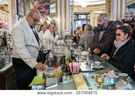 Naples, Italy - December 3, 2017: Unidentified people visiting famous italian cafe Gambrinus. It is a historical coffee shop in Naples