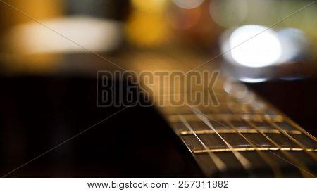 Acoustic Guitar Bridge And Strings Close Up. Close-up Of Guitar Strings. Elegant Guitar.