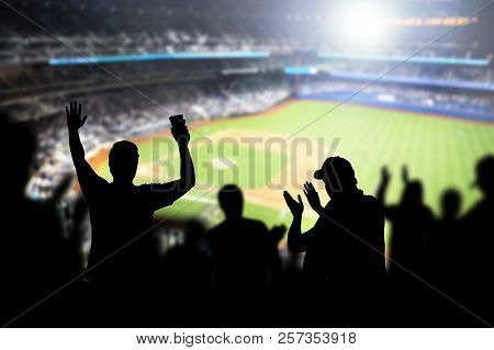 Baseball Fans And Crowd Cheering In Stadium And Watching The Game In Ballpark. Happy People Enjoying