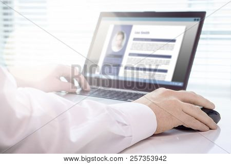 Job Seeker And Applicant Writing His Resume And Cv With Laptop. Modern And Visual Electronic Curricu