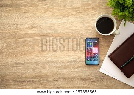 Alushta, Russia - August 26, 2018: Iphone X With Home Screen Control Center And Background Wooden De