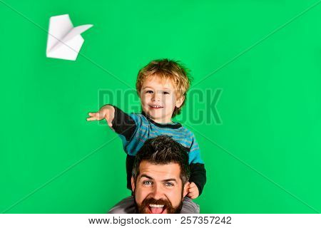 Father And Son Testing Paper Plane. Happy Daddy&son Launch Paper Plane. Little Boy Is Sitting On His