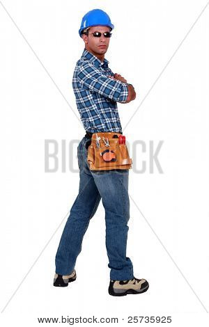 Arrogant tradesman wearing sunglasses