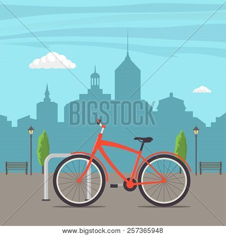 Bicycle Parking On A City Street. Bike On Urban Background. Cute Red Bicycle, Parked In The City, Wi