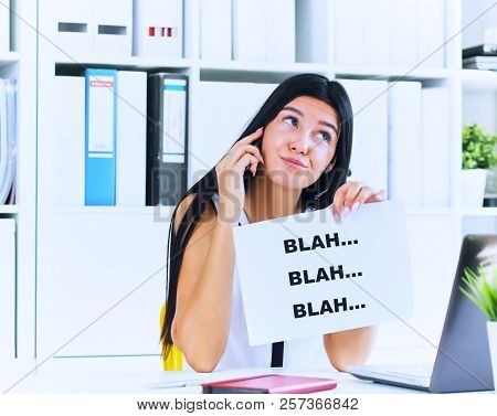 Young businesswoman in the process of useless conversation with the client or boss. Effective communication concept. poster
