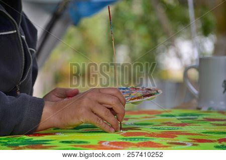 Palette With Paints And Brush In Hands Of Artist, South Bohemia, Czech Republic