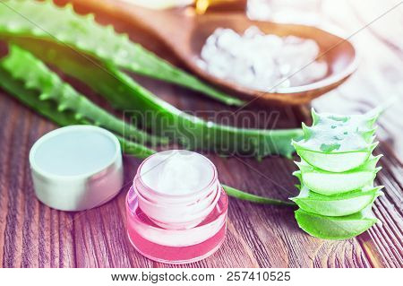 Aloe Vera Gel And Rock Salt Minerals Skin Cream On Wooden Background. Organic Skin Care And Natural