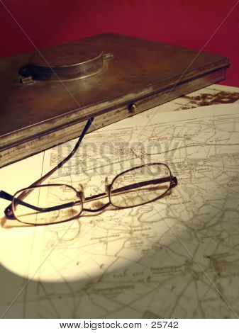 Glasses On An Old Map