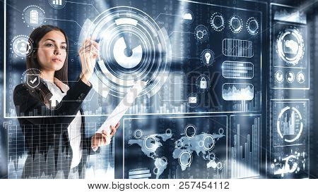 Attractive European Businesswoman With Digital Business Interface. Future And Media Concept. Double