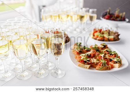 Solemn Happy New Year Banquet. Lot Of Glasses Champagne Or Wine On The Table In Restaurant. Buffet T