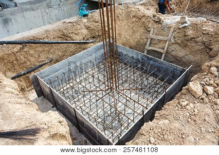 Foundation Construction Building Site Making Reinforcement Metal Framework For Pouring Concrete. Met