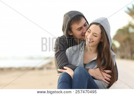 Front View Portrait Of A Happy Couple Of Teens Flirting On The Beach