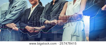 Double Exposure Business People Holding Hands Together Showing Workers Relationship, Unity And Teamw