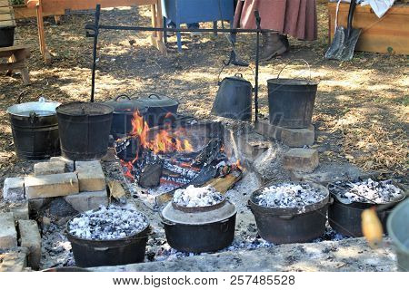 Outdoor Cooking Over A Open Fire With Cast Iron Pots And Egg  Coffee Being Made With A Metal Coffee