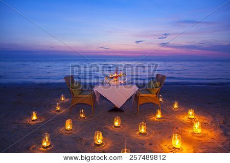 Glass Of Wine And Equipment On A Wooden Table With Seascape And Skyline In The Evening With Sunset T