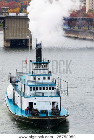 Front view of a paddle boat steamer on the Williamette river in Portland heading down river