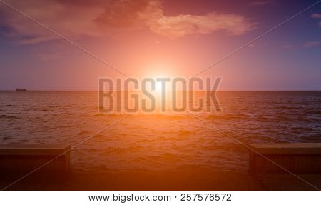 Sunset On The Background Of The Sea And The Pier.