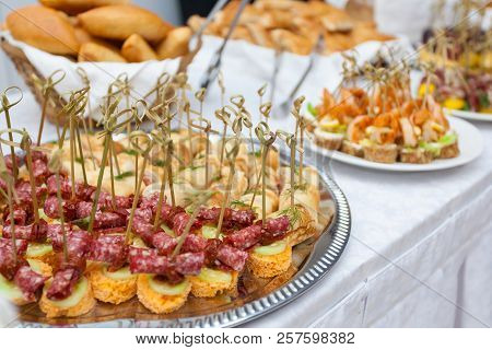 Food Snacks And Appetizers With Meat And Seafood On Table. Catering Banquet Table. Catering Party. C