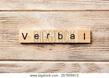 Verbal Word Written On Wood Block. Verbal Text On Table, Concept.