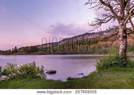 French Landscape - Jura. View Over The Lake Of Ilay In The Jura Mountains (france) At Sunset With Ro