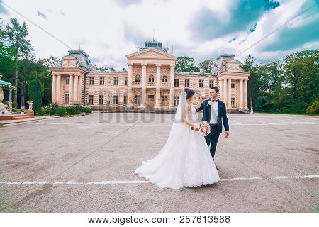 Sensual Wedding Married Couple, Valentines Hugging In Front Of Old Slavic Castle. Wedding Day Of Bri