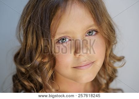 Close Up Portrait Of The Beautiful Little Girl