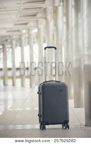 Travel Gray Luggage Or Suitcase At Airport.lost Luggage While Traveling.tourist Forget Suitcase In A