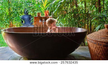 Happy Baby Boy Have Fun In Bathtub. Joyful Child Take Bath In Outside Bathroom On Open Veranda With
