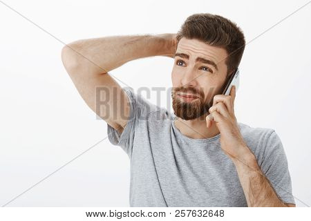 Guy Intense, Awkward Trying Say No During Phone Call. Unsure Hesitating Handsome Boyfriend With Bear