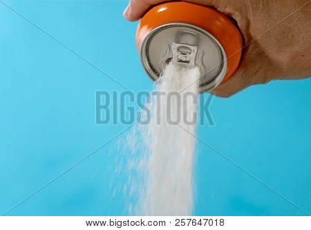 Hand Holding Soda Can Pouring Lots Of Sugar In Metaphor Of Sugar Content Of A Refresh Drink In Healt
