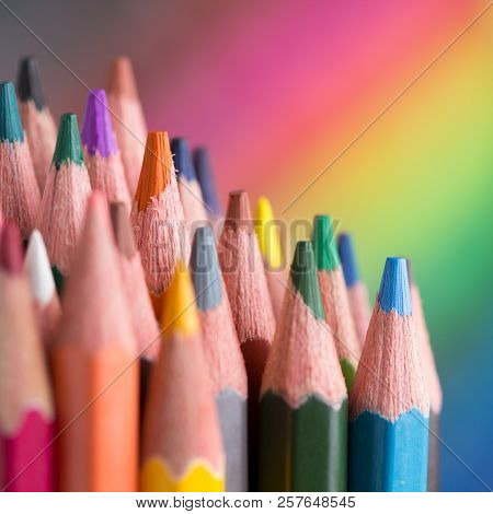 Color Pencils On Rainbow Background Close Up