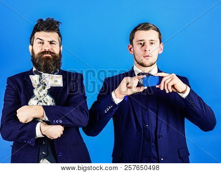 Men In Suit, Businessmen With Jar Full Of Cash And Credit Card, Blue Background. Crediting Concept.