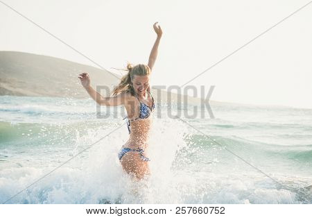 Young Woman Enjoying Warm Waters Of Mediterranean Sea, Greece