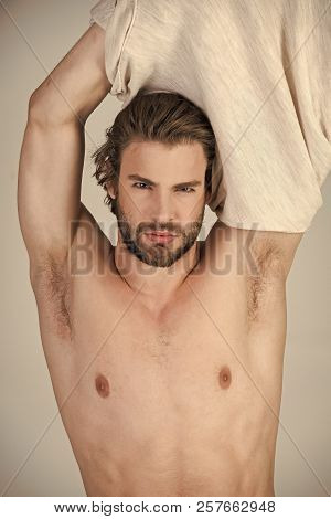 Sleepy man undress on grey background. Man with disheveled hair in underwear. Barber and hairdresser, male fashion. Insomnia, energy, single with uncombed hair. Morning wake up, everyday life. poster