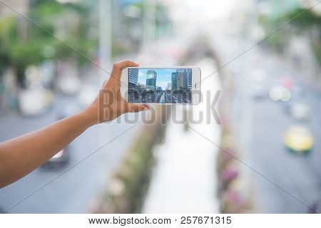 Taking A Photo Of A City Tower In Bangkok, Taking Photo With Smartphone