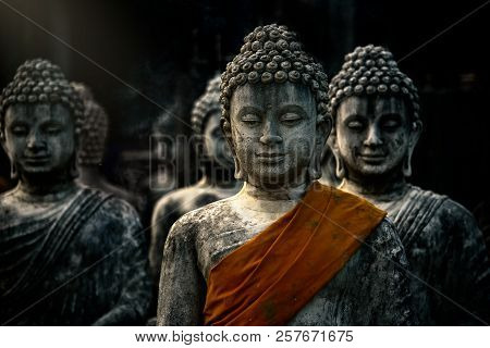 Buddah Statue With Ancient Stupas With Orange Cloth In Buddhist Temple On Black Background At Sarabu