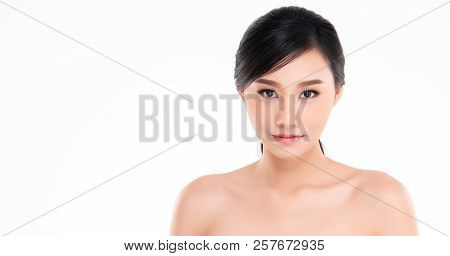 Beautiful Young Asian Woman With Clean Fresh Skin Look Away, Girl Beauty Face Care. Facial Treatment