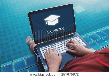 Online Education, E-learning And E-book Concept. A Man Using Computer Laptop For Education On Weeken