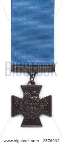 A British Victoria Cross with a blue ribbon. Prior to 1918 medals issued to the Royal Navy were suspended from a blue ribbon. With the creation of the Royal Air Force the crimson ribbon became standard. poster