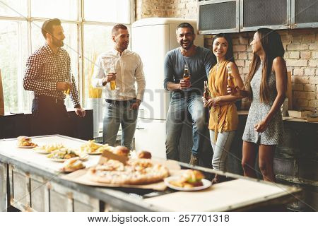 Home Party. Full Length Of Cheerful Young People Enjoying Home Party While Communicating And Eating