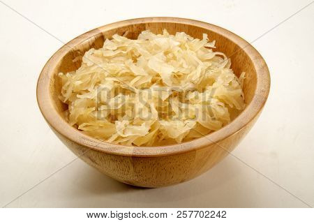 Home Made Sauerkraut In A Wooden Bowl On Bright Background