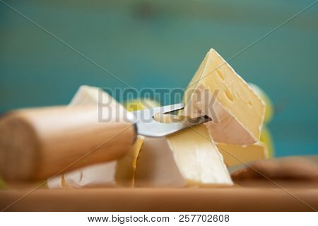 Slices Of Cheese Camembert On A Cutting Board