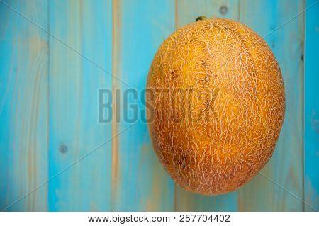 Fresh Organic Melon On Blue Wooden Background