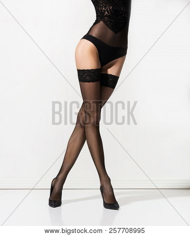 Fit And Seductive Woman In Nylon Stockings.