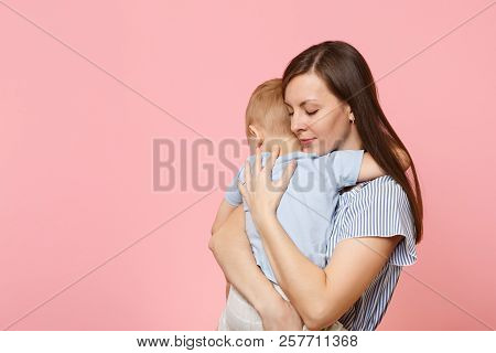 Portrait Happy Young Family. Mother Keep In Arms, Tender Embrace, Gently Hugs Child Kid Son Baby Boy
