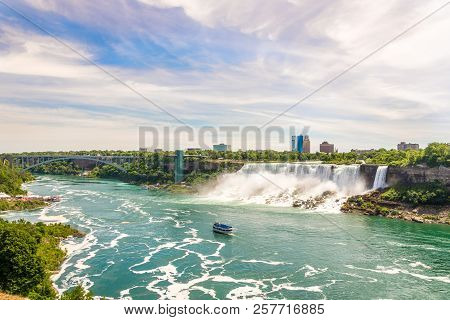 View At The Rainbow International Bridge Over Niagara River With American Falls And Bridal Veil Fall