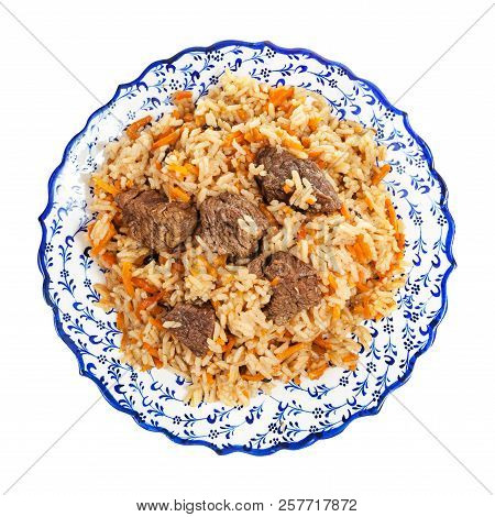 Top View Of Cooked Pilaf (central Asian Dish From Rice With Meat And Vegetable) On Local Ceramic Pla